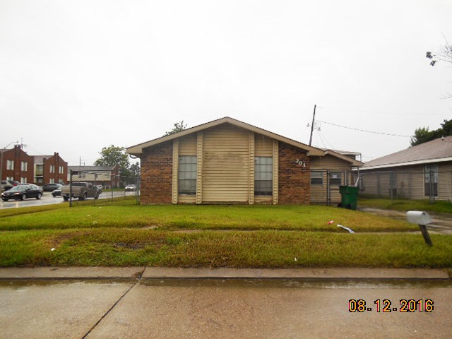 Corner lot with possible rear yard access. Mostly tile floors, large covered rear patio.