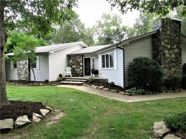 "ONE LEVEL, MOVE IN READY! Beautiful, maintenance free home boasts solid hardwood floors throughout, stone FP w/gas logs and custom mantel. Bright, spacious rooms. Master suite has double vanity, large shower and walk in closet! Stainless appliances, granite counters in kitchen. Many closets. Park setting with private back yard, two spacious decks, three car garage with great office. Two car garage is 9'6"" high. New 12x16 storage building. Abundant parking. Walk or drive your golf cart to golf!"