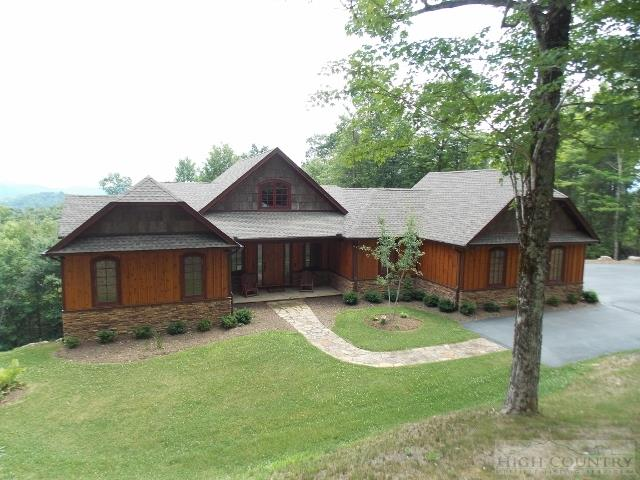 Beautiful newer custom built home being sold furnished with pretty views located in The Headwaters at Banner Elk private gated community. Just a 12 minute drive to downtown Banner Elk. This community gives you the illusion of seclusion. This home has a level entry driveway with lots of parking and easy in and out access. Home features include: beautiful hardwood floors and high vaulted tongue and groove ceilings throughout this home, stone fireplace, stainless steel appliances, granite countertops, open and covered outdoor living space and close proximity to the clubhouse. Must see for yourself! Ask your agent for POA information.