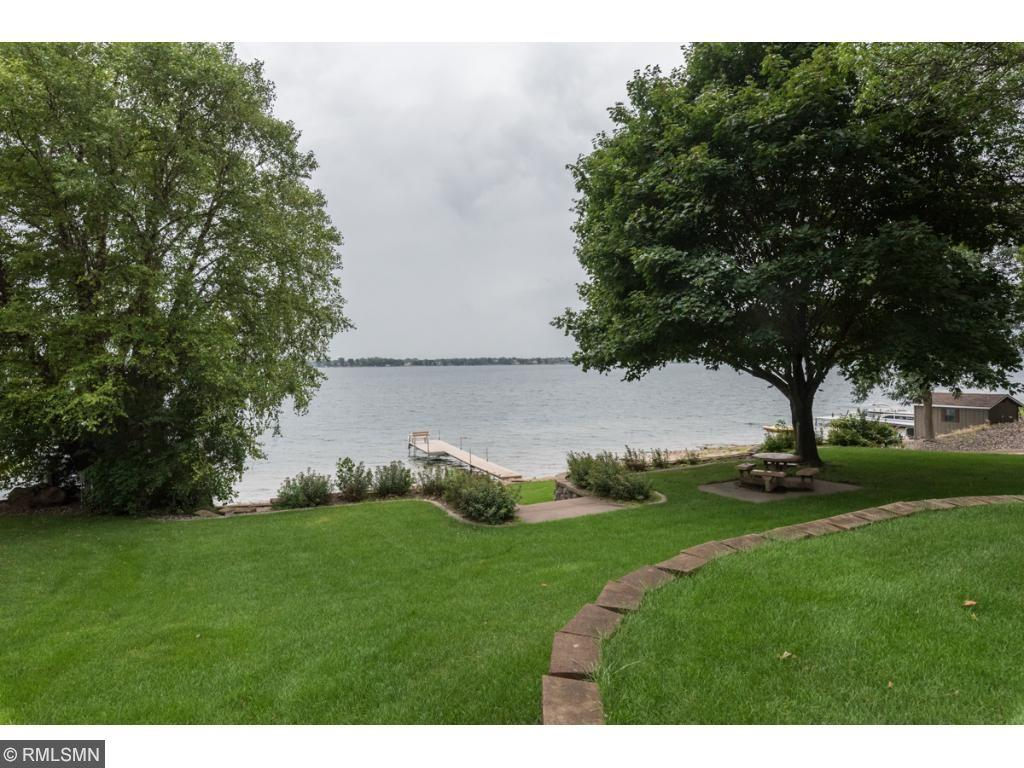 Buffalo's best kept secret! Beautiful Pulaski Lake deeded/association Lake front w/PRIVATE sand beach, Dock, boat launch, BBQ/picnic, fire pit & gathering area. Just ft from your doorstep. All the perks of beautiful lake front living WO high taxes. Gr updated home w/hg 3&4 season porch. 4bed/3bth/3car. Gorgeous lot w/lake views. Lrg rms open & vaulted flr pln. Lrg kt w/granite island HDW flrs. tons of storage. In gr sprinkler. Rare opportunity. Only 14 homes in association & only $25 a month!!!