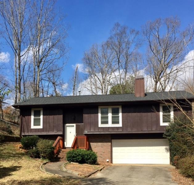City home! Close to schools, shopping and downtown! This 4 bedroom, 2 bath home needs some love, but has a new HVAC and a fresh coat of interior paint.