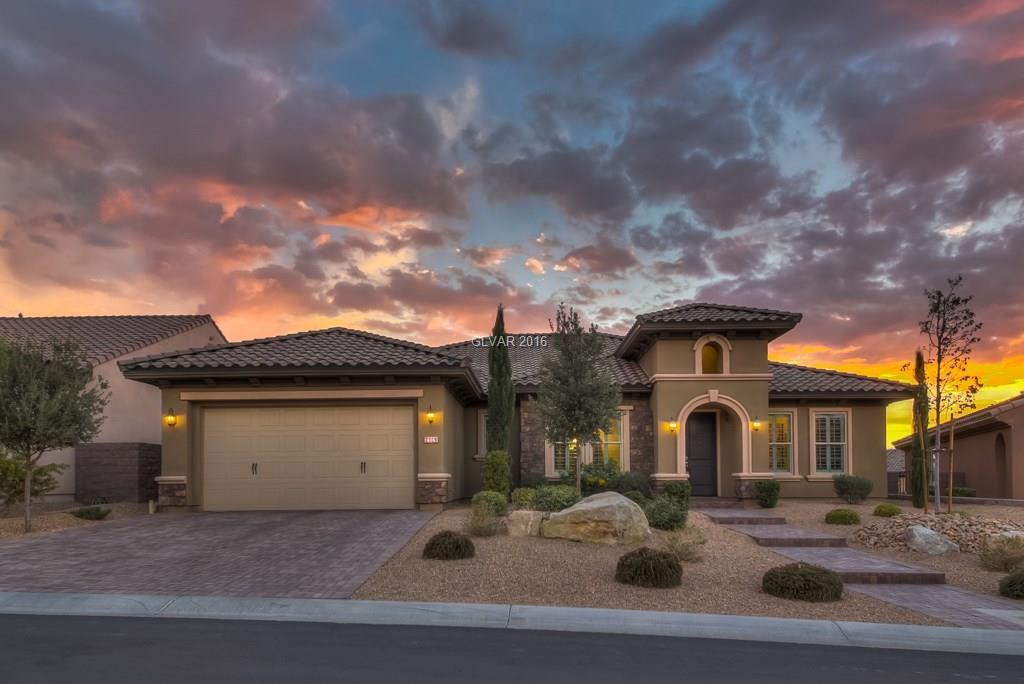 """Guard-gated Madeira Canyon w/Mountain Views.  Wood floors and 18"""" diag porcelain tile. Chefs granite island kitchen w/custom cabinets, Double Oven, 5-Burner stove w/hood, walk-in & butler's pantry.  Master w/mosaic tile surrounds separate tub.  Large Private backyard w/covered/pavered patio, 7 person spa w/waterfall, fire pit, fountain, surround sound, room to expand.  Pergola covered BBQ island w/marble counters & ice chest."""