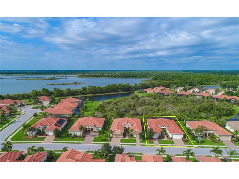 """The natural beauty of Florida, fully presented to you, the moment you open the door…Looking past the grand foyer, through the expansive great room, through the 2 sets of sliding glass walls, out to the shimmering pool is the perfect backdrop, along with the waterways connected to the Mayakka River. Ideally situated on a premium, private preserve lot is your beautiful Agostino Model the MOST popular in the Classic Series.  This tri-split plan features 3 ensuite bedrooms + Office, 4 Full baths, 1/2 bath,3 TRUE car garage. Soaring ceilings accented w/trays & designer paint is the quintessential canvas for the bright & shimmering Florida light! The gourmet kitchen is a Chef's dream with 42"""" cabinets, sparkling granite & travertine backsplash, Stainless appliances, Gas range – all centered around the island bar.  The epitome of open concept living & perfect for entertaining! """"Florida Living"""", commonly defined by Indoor/Outdoor Living as One, is a breeze in the oversized great room where the walls of glass disappear to expose nature & all its glory.  Relax to the sounds of song birds & the waterfall on your expansive lanai, complete w/ cabana bath; it all comes together for your perfect place to call home!  This is more than a home purchase, The Venetian Golf & River Club is a Lifestyle Purchase; a World-class resort style community with social events & amenities including tennis, dining, fitness center, resort & lap pools, a Chip Powell designed Par 72 18-hole Golf Course, trails & paths, Guarded & Gated 24/7."""