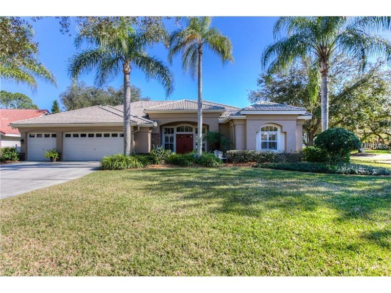 """Welcome to a meticulously maintained and beautifully updated CUSTOM Sabal Home with 4 bdr (3 way split!), 3 bth, 3 1/2 CG, and Saltwater Pebble Tec Pool! A GRAND ENTRY into the living and dining room greet you with tray ceilings, crown molding, and hardwood floors! Upgrades abound in this TRUE CHEF'S KITCHEN featuring a THERMADOR gas top dual fuel convection range, top of the line SS appliances, custom 42"""" solid wood cabinets, upgraded soft close doors and pull outs, gorgeous premium granite and a custom handcrafted wood and iron wine rack with dry bar and wine refrigerator. NEW A/C, NEW Gas HW Heater, and NEW Bosch DW in 2015. Relax after a long day in your exquisite master bath which boasts a soothing soaking tub, separate shower and dual sinks with granite. Guest bath updated in 2013 and exterior painted in 2011 so, you will only need to add your personal touches to move in! Triple 8ft hide away sliding doors open to the beautiful brick paver lanai inviting you to entertain in the great Florida outdoors! Oversized nearly a 1/2 acre corner lot is awesome for playing catch and outdoor games. Owners proudly enjoy impeccable common area maintenance, 5 parks (including a riverside park with fishing and camping), community recreation center, heated pool, tennis, volleyball and bike paths. Tampa Palms has everything your heart desires! Private gated village with easy access to I-75, I-275, USF, Moffitt, Florida Hospital, schools, shopping and championship golf courses!"""