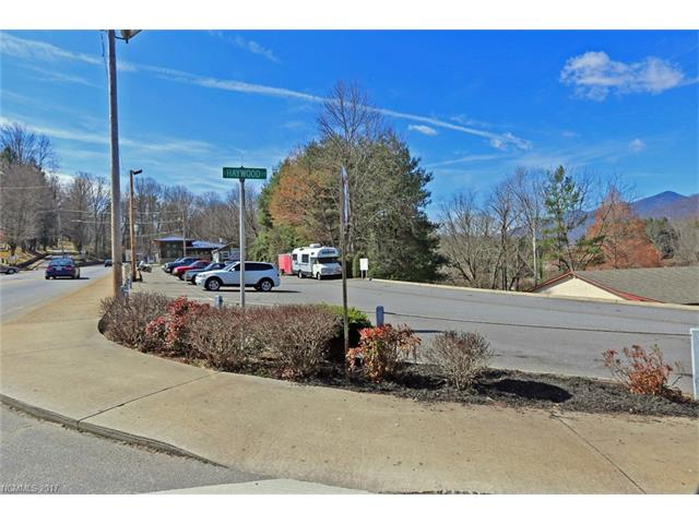 Investment opportunity. 10,960-square foot strip center with 11 roadfront stores, one 288-square foot stand-alone building and one 2,288-square foot home with upper and lower living quarters. Approximately 92 parking spaces. City utilities. Walking distance to Downtown Waynesville. All building features and information to be verified. Additional PINs included (8615-25-1596, 8615-25-1741).