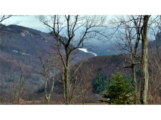 TRULY INCREDIBLE VIEWS FROM THIS LEVEL LOT IN A GATED COMMUNITY. TAKE IN BEAUTIFUL MOUNTAIN VISTAS AND EVEN LAKE LURE IN THE DISTANCE.  YOU CAN SEE FOR MILES!  EASY BUILD LOT THAT IS SURPRISINGLY LEVEL TO HAVE SUCH AMAZING VIEWS! - NO BUILDING ON A CLIFF HERE!