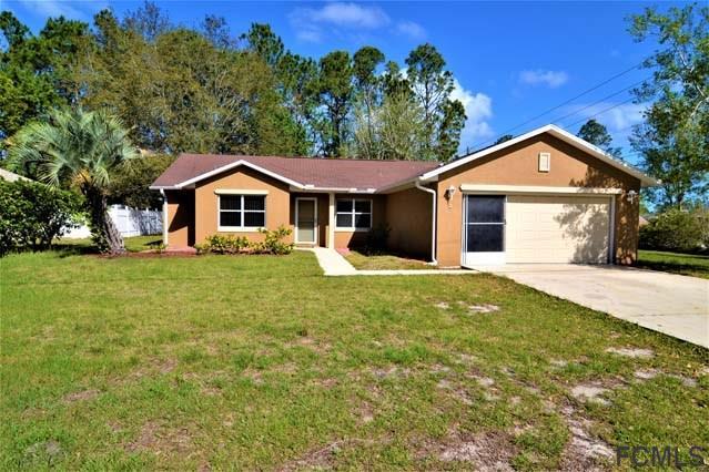 2 Pin Oak Dr, Palm Coast, FL 32164