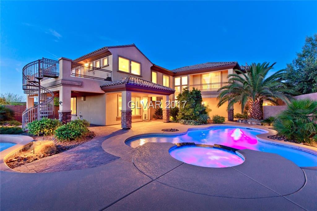 Unbelievable Views. Most desirable street in Madeira Canyon.  270 degree strip, city & mountain views! Guest house, large unique zen backyard paradise with private pool, spa, & large observation balcony with spiral staircase, & multiple covered patios. Gourmet kitchen with granite counters & back splash, stainless appliances, butler's pantry, & coffee bar. Spacious master walk-in shower, his & hers walk-in closets, multi-media system throughout.