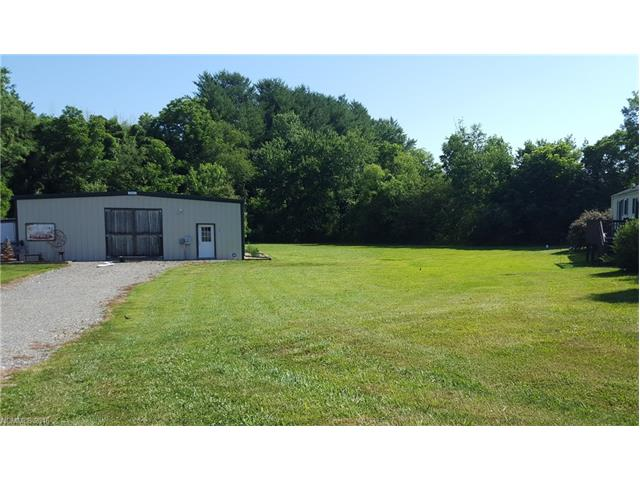 Possible Owner Financing. Lot is good for a warehouse or storage building.  Site plan is available and can be built if desired, similar to one next door. Give us a call for more information. LOT DOES NOT PERK SO NO HOUSE CAN BE BUILT ON IT.  Lot is located between a warehouse on left and duplex on right.
