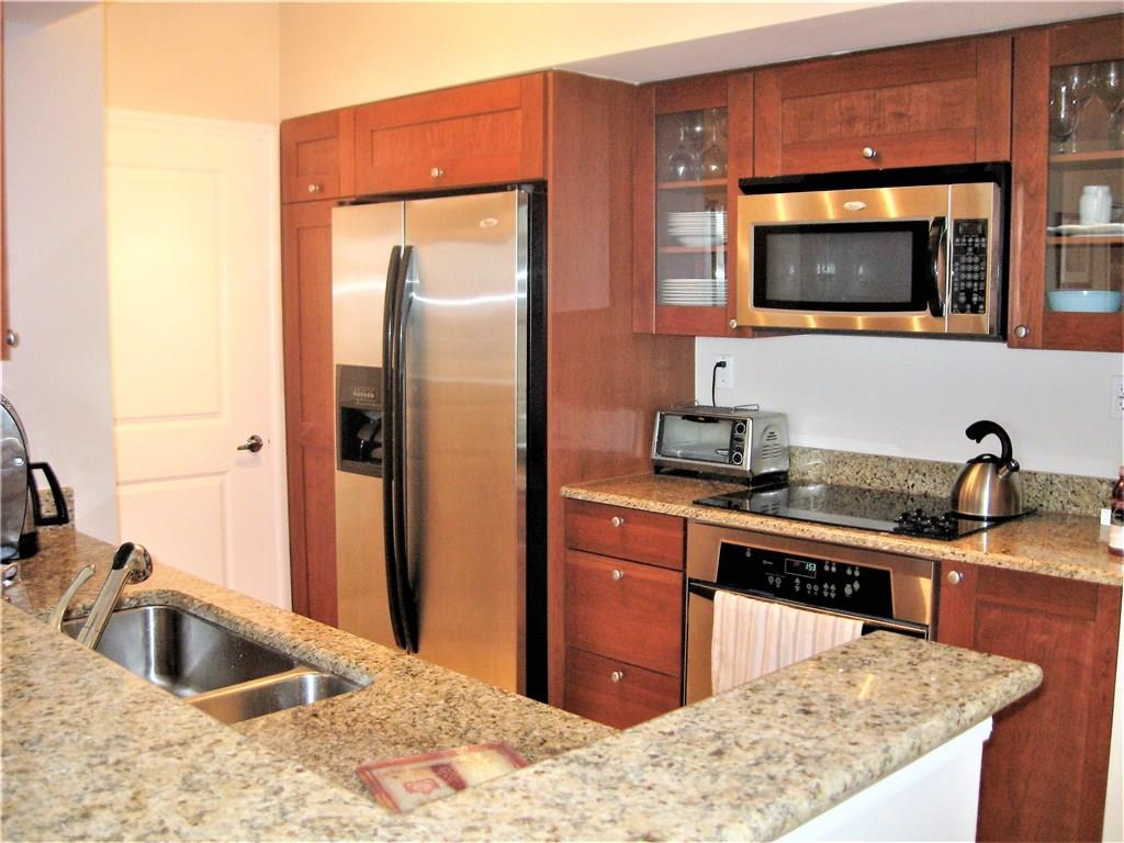 Contemporary elegance with island charm. Move right into this beautifully appointed condo where no quality detail has been spared in the renovation. Different than the typical builder grade with marble flooring throughout and custom vanities in master bath and guest bath. In-unit laundry room with washer and dryer off the granite and stainless steel kitchen. Master suite has walk-in closet, luxury bath with whirlpool tub, dual vanities, and room for a King sized bed. Wrap balcony offers spectacular view day or night of downtown Stuart and the St. Lucie River. The Yacht Clubhouse features heated pools, hot tub, fitness center, restaurants, billiards, men and ladies spa with sauna and steam rooms and more. Full service marina will accommodate up to 120' vessels with slips available for lease. Very short walking distance to downtown Stuart for shopping, dining and entertainment.   Currently rented until Jan 2018 at $1,800 mo.