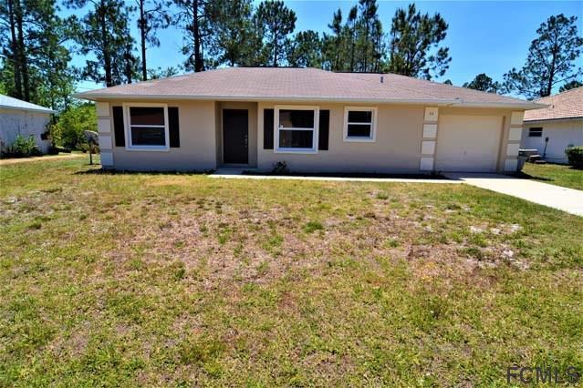 32 Pine Hill Ln, Palm Coast, FL 32164