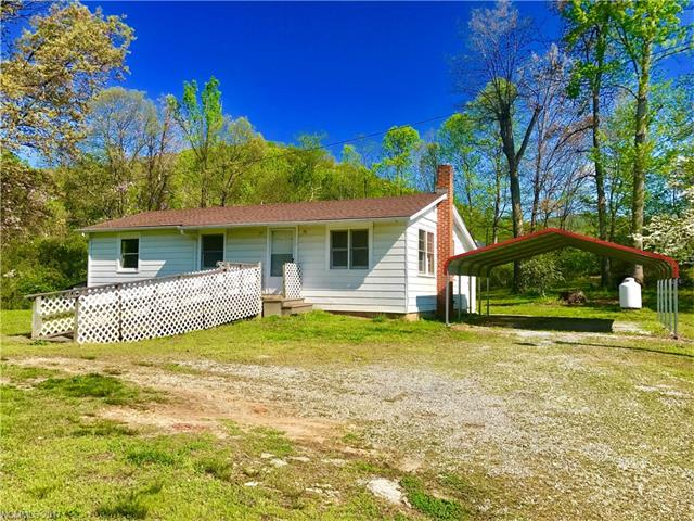 This small country home is heated by a propane heater.  About 350 square foot bonus room is unheated.  Level to sloping land with stream, old barn and several outbuildings on property. Unrestricted! A mini-farm possibility.