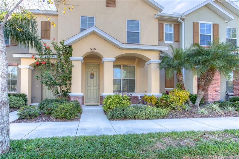 Immaculate 3 bedroom, 2.5 bathroom Hampton Lakes at Main Street Townhome! No CDD, low HOA! The large living room and dining area flow seamlessly into the kitchen, perfect for entertaining. Gleaming hardwood floors! The gourmet kitchen includes granite counters with, 42