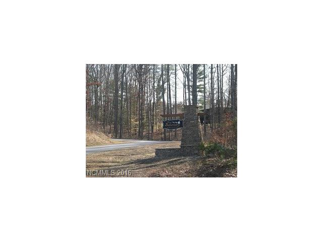 ONLY LOT available in The Sanctuary at Mills River.  Great location across from Sky Top Farms, wooded, peaceful setting.  4BR septic permit available.  City water & natural gas available, underground utilities, road built to state specs.  Plat Slide 7332 HCR