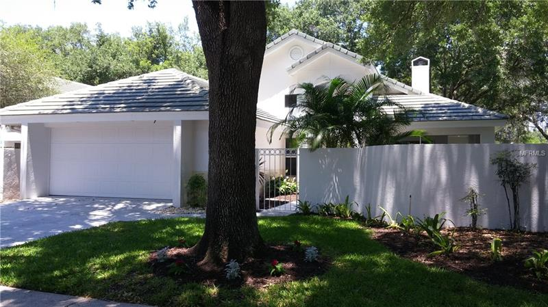 """Updated Maintenance Free living in this move-in ready home in the highly desirable gated community of Tampa Palms. A screened patio opens to the fully enclosed fenced in private courtyard. This open concept home also features a fireplace with high vaulted ceilings in the living/dining room area. New hardwood flooring throughout flows into a modern kitchen layout that has been updated with Granite counters, 42"""" cabinets, new stainless steel appliances, walk in pantry, and sky lights. The master bedroom with a cathedral ceiling features a large en-suite bathroom with a large walk-in closet, dual sinks, and a large custom his & her spa walk-in shower. Monthly HOA fees cover all exterior maintenance including painting the house once every five years, trim trees and bushes, mow and blow leaves. They also maintain the sprinkler system. Amenities to the residents of Tampa Palms include the use of its five parks. There's River Park, a 45-acre nature preserve on the Hillsborough River with docks and launches that provide kayak and small boat access, miles of hiking trails, camping, grilling and picnic pavilions. Oak Park is a 10-acre conservation area with walking and 25 miles of biking trails and protected gopher tortoises. The other three parks scattered throughout Tampa Palms have amenities including pool, playgrounds, community centers, meeting rooms, basketball, volleyball, lighted tennis courts, and fitness centers."""