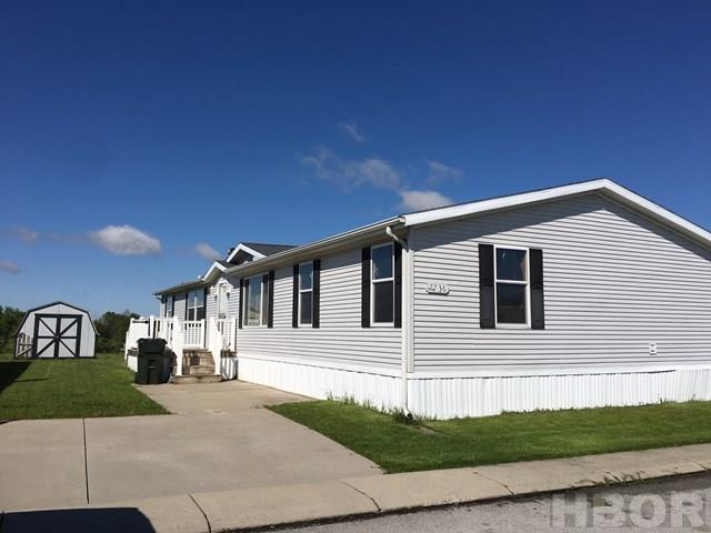 A Rooney & Associates listing. Contact Kim Cameron at 419/306-7823 or Brian Whitta at 419/701-4040 for more information. Located in Deer Ridge Mobile Home Park.  Nice manufactured home with a living room and cozy family room that features a fireplace surrounded by built ins.  Nice kitchen with ample cabinets and stainless steel appliances.  Split bedroom floor plan. Spacious master bedroom with private master bathroom and large walk in closet.  Storage shed.  Lot rent is $265 per month and includes trash service.