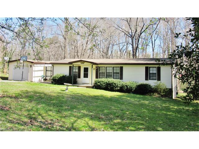 COUNTRY SETTING CLOSE TO SHOPPING & INTERSTATE ON .60 ACRE LEVEL LOT.  SPACIOUS MANUFACTURED HOME IN GOOD CONDITION WITH 16X10 SUN ROOM (BASEBOARD HEAT) & STICK-BUILT ADDITION BEING USED AS A DINING ROOM BUT COULD ALSO BE A DEN. OPEN FLOOR PLAN. 23X16 GREAT ROOM WITH DINING AREA, WOOD STOVE & VAULTED CEILING. SPLIT BEDROOM ARRANGEMENT. ATTACHED 24X14 GARAGE WITH GARAGE DOOR OPENER. RELAX ON LARGE DECK OVERLOOKING LEVEL BACKYARD. AFFORDABLE!!!