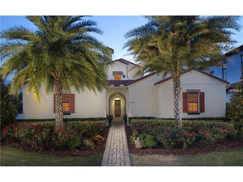 """Discover elegant living in this 4 bed/4.5 bath impressive Spanish Colonial style home w/ a private courtyard & salt water pool. Small GATED neighborhood, just a short commute to everything Orlando has to offer- downtown, theme parks, shopping at Lakeside Village & the airport.  This corner lot home is the ultimate luxury escape-an inviting floor plan w/ abundant space for everyday living & entertaining. Modern concepts abound w/ long lasting durable tile roof, stainless steel appliances, tray ceilings & exposed Cypress beams.  Whip up fantastic culinary creations in the gourmet kitchen showcasing, granite counter tops, Viking appliances including double oven & island.  The family room features an intimate yet open concept w/ sliders that open to the outdoor living space that backs up to a pond & wetlands. Private FIRST FLOOR MASTER boasts 6"""" plank hand scraped hardwood floors & 7.5 crown molding while the large private master bath showcases 20"""" inch seamless travertine. **1st-floor bedroom could be used as guest suite w/ its own private entrance**.  Make your way upstairs & enjoy the theater/bonus room or watch Disney fireworks from the screened lanai.  The salt water pool & lanai has something to offer whether you are a BBQ chef, entertainer you'll love the 36"""" BBQ grill to the pool and spa & the outdoor cabana.  Walking distance to the elementary school & zoned for the new Windermere high.  With room to relax inside and out this home is the perfect place to call home!"""