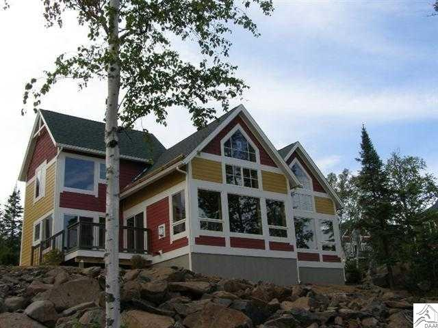 The newest addition to the Cove Point family. Cottage is located just a few steps from Lake Superior. The cottage is a deluxe 2 bedroom, 2 bath w/Jacuzzi tub, extensive use of tile, wood, and granite. Features include extra large windows in order to proved an expansive view of the lake. This cottage has 3 flat panel televisions. All lodge facilities including the dining room and pool are just a few steps away along a cozy path