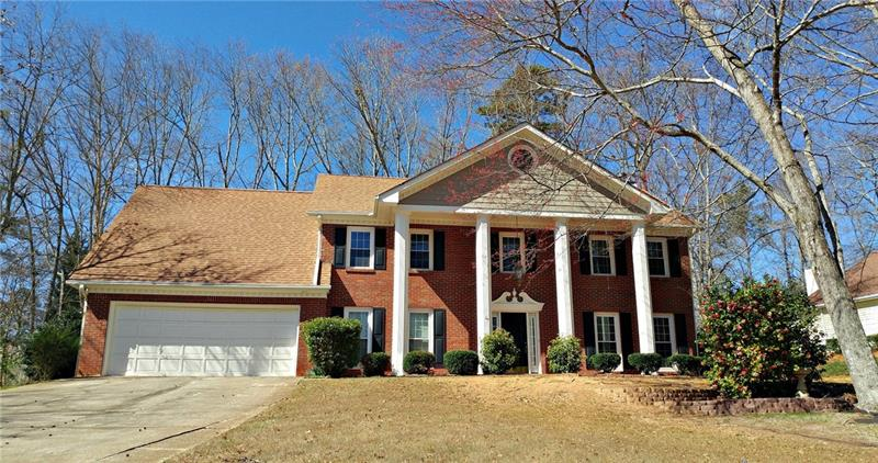 Popular Established Neighborhood in Buford City School district! 4 Large Bedrooms/2.5 Baths. Formal LR & DR Kitchen has granite counter top in island. Large sun room with tons of windows looks out over the lovely and very private fenced back yard with extended patio areas. Nice features such as hardwoods, built-ins, oversized his/her master closets, spacious master suite with trey ceilings. Priced under market.