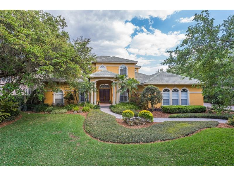 Originally custom built for an all-star pitcher, this grand 5 bedroom/4.5 bath home boasts over 5000 sf on ½ acre in the exclusive neighborhood of The Reserve in Tampa Palms.  When you first enter this elite community, you will pass through the guard gate, which leads to a winding drive past several stately homes before pulling into the fully pavered driveway and 3 car garage.  Inside, only the finest finishes are seen throughout the main floor including custom wood cabinetry, granite counters, travertine marble, and hardwood floors.  The gourmet kitchen features Miele dishwasher, Thermador range, Sub-Zero refrigerator, separate icemaker and walk-in pantry.  The open concept kitchen and family room flow out French doors to the large patio that overlooks the pool and the immaculate Tampa Palms golf course.  The poolside cabana houses an additional half bath and outdoor kitchen.  At night, retire to the expansive master suite, which is designed to pamper with his and hers walk-in closets and large master bathroom.  Through the bathroom is the perfect nursery or exercise room.  A lovely guest suite, an office, and a laundry room are all  conveniently located on the first floor.  The dining room and living room, with gas fireplace, provide the perfect space for entertaining.  The upstairs includes a large loft, 2 bathrooms and 2 bedrooms with walk-in closets.  Beautifully designed and appointed, this house is the perfect blend of luxury and comfort for any family! The virtual tour provides a 3D walkthrough.
