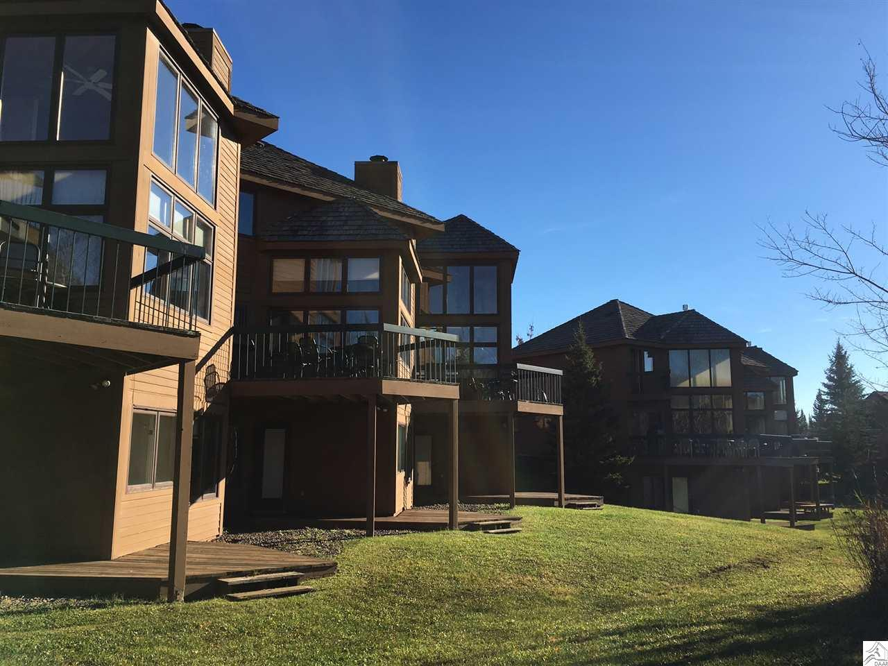 This is a lovely four bedroom vacation home large enough to bring your family & your friends! This home can be used for year round living or you can be part of a resort rental program that will provide monthly revenue. Large spacious home located on Lutsen Mountains, offering 4 Bedrooms, 4 Baths, spacious workable kitchen, living room with a large stone fire place - a perfect gathering spot! All of you recreational needs outside you door.