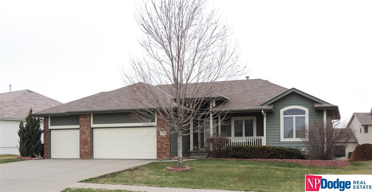 Custom walk-out Ranch. Tile entry,GR w/vaulted ceiling&gas FP. KIT w/lg dining area,lots of cabs,counter space,2 pantries&center isl. Master w/raised ceiling,Walk-in Closet&Bth w/corner jet tub,sep shower&counter height vanity. Main incl another BR w/Bth&Office. Fin LL w/new carpet,lg FR&2add BR's,3/4Bth, Playroom& unfinished area. Lg backyard,Deck,Patio&no-maint cement board siding. Near neighborhood elementary school,park,walking trails,shopping&min from Offutt AFB. 1yr 2-10 Warranty offered