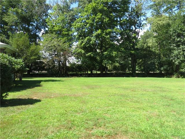 """Walk to Westport's award winning schools; Bedford Middle School and Staples High. Beautiful, desirable flat piece of land privately set back approximately 900 feet off North Avenue bordering Bedford Middle School, Melon Patch Lane and Wakeman Farm.  Please do not """"drive by"""" or go to property without an appointment."""