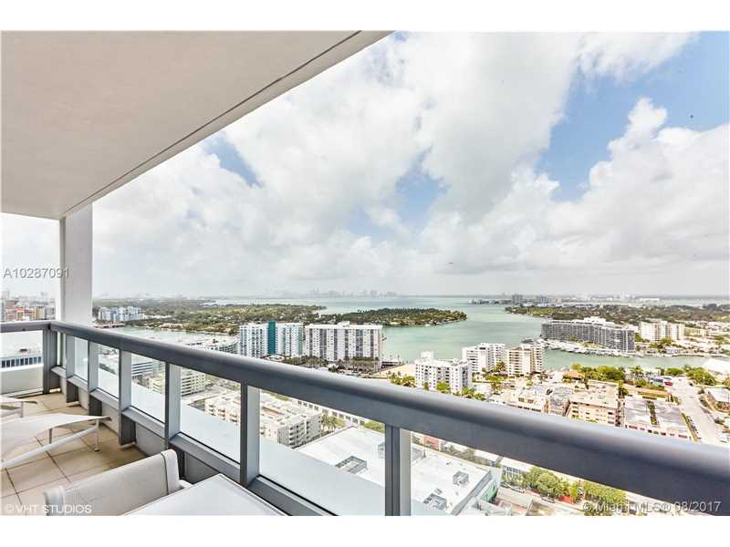 Exceptional 2 bed/2bath unit with breathtaking water views of Downtown across Biscayne Bay. This full furnished, decorator finished unit comes with every detail including Lutron electronic sheers and black out shades. Carillon has full range of daily fitness classes; multiple healthy eating restaurants & bar plus outdoor pool cafe; 70,000 sf luxury spa w/beauty salon; 4 pools; beachfront chair/towel, food & drink service. Resort living at it's finest. Sit at the beach all day and then have your cocktails