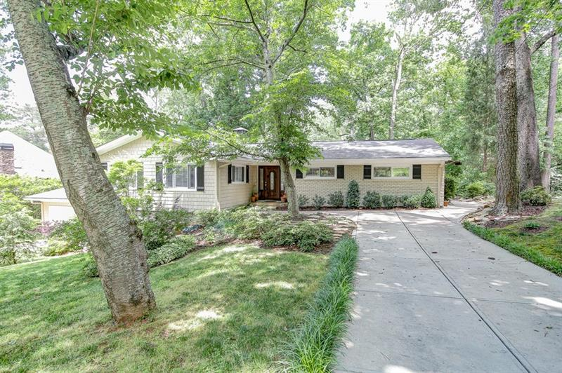 Wonderful home in Pine Hills! Open kitchen feat s/s apps,granite counters,tile backsplash,b'fast bar,& pantry! Formal din rm great for entertaining & opens to liv rm w/ wood-burning FP! Fam rm boasts heated flrs! Master has dual closets & updated bath! Add'l bdrms well-sized & bright! Fin basement adds liv space w/ full bath, possible 4th bdrm, & rm for kitchen! 2 car garage & dble driveways provide ample parking! Lg deck overlooks priv & serene backyard! Amazing location convenient to interstates,shopping,& restaurants! Roxboro Valley Swim Club around the corner!