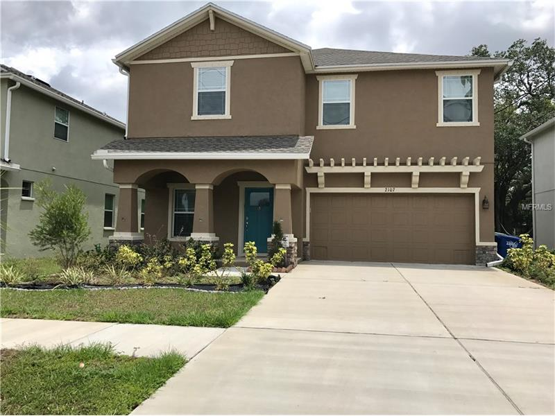"""New listing in highly sought after location! Late 2015 Built Domain Home. Contemporary, open, light & bright 4 bedroom 2.5 bath priced to sell! Listed at APPRAISED value conducted 5/23/2017 (available for buyer review) so it won't last long! Turn key beauty has 2442 sq. Ft. of living space with a much coveted Huge (19 FT) game room & beyond Spacious (19 FT) master suite. Featuring designer neutral tone paint, 42"""" wood cabinetry, 20 x 20 neutral color tile, plenty of storage space, large walk-in closets, archways & volume ceiling. The cook will love the well appointed large center island kitchen with lots of thick granite counter space, nook, plenty of tall cherry cabinets & nicer stainless appliances. Super sized master suite/bath includes garden tub, dual vanity & separate shower. 2015 built so utility costs are low due to energy efficient low-e-windows, better insulation, and high sear a/c.  Also noted; double tray ceilings, lots of recessed lights throughout, contemporary fixtures, ceiling fans & more storage space! 11x20 covered lanai & 143 Ft deep lot provide for a perfect backdrop for your outdoor living space.  This mega yard with tree lined view has more than ample space to add a large pool! Location with very quick access to I-275. Literally minutes from the airport, shopping, medical facilities, higher education, dining, and more. Located walking distance to beautiful tree lined MacFarlane Park & the MacFarlane Park International Baccalaureate Elementary Magnet School."""