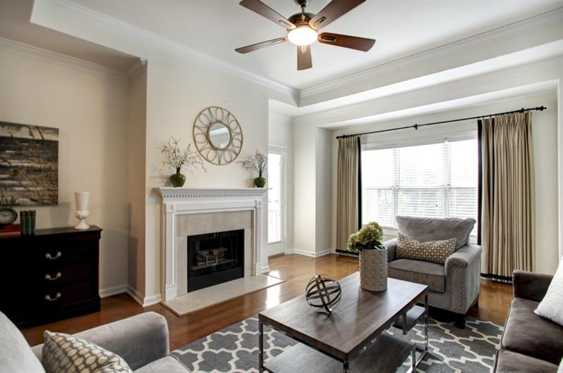 Hurry! Perfect top flr, corner unit in River West! Kitchen feat s/s apps, granite counters, tile backsplash,under cabinet lighting,wine rack,& b'fast bar! Spacious liv/din area perfect for entertaining & accented by hrdwd flrs, tall trey ceiling, & gas FP. Master bdrm boasts walk-in closet & access to hall bath. Add'l bdrm well-sized & bright! Wrap-around balcony ideal for outdoor enjoyment. Wonderful amenities include pool,clubhouse,gym,dog park,& gated/secure access. Great location convenient to interstates,shopping,restaurants,& new SunTrust Park! New carpet & paint!