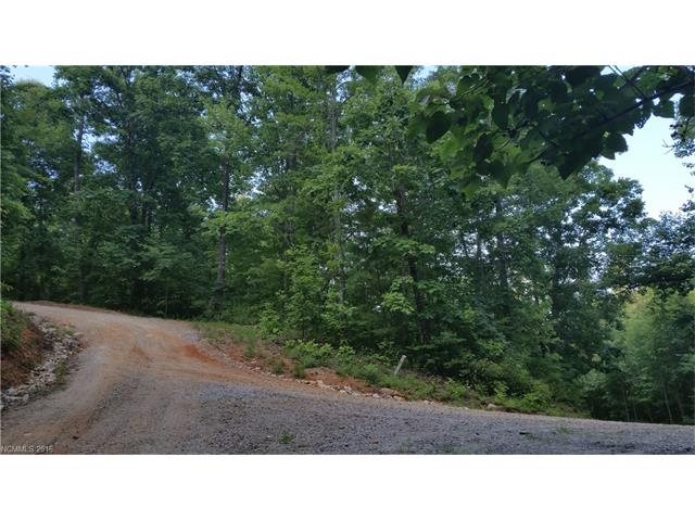 Private wooded corner lot in Stoneridge Estates. Winter views, gently sloping, underground utilities. Great lot to build your dream home. Off frame modular homes are allowed.
