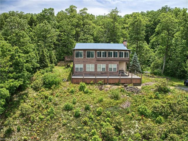 180 degree majestic views offered by this custom one-owner log home. Wake up refreshed from the cool mountain breeze, listen to the sounds of nature & distant water trickling from a nearby creek & waterfall. Weather you decide to live here year round or part time, this is the one of a kind home people dream of owning. Featuring 2.7 private, natural acres, a finished private lower level and a small area fenced for your beloved pet. Located approximately 15 minutes from every day conveniences.