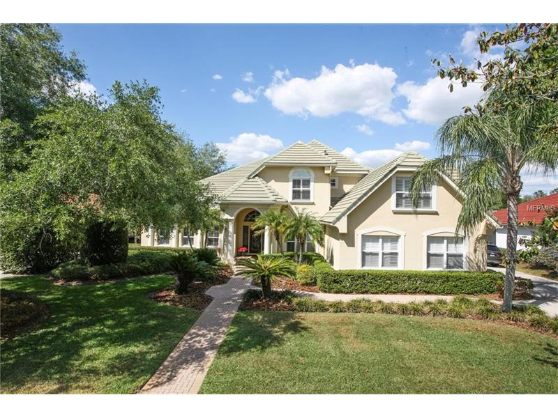 """Discover an architectural beauty, hidden treasure tucked amidst the grand oak trees in tranquil & pr.estigious """"Kensington"""" at Tampa Palms. Custom remodeled estate in gated village. 4,804 SF, 4 Bed, bonus room, office, 4.5 baths, 3 car side entry garage. Impressive curb appeal with tile roof, paver walkway and meticulously trimmed, mature landscape. Be greeted by a foyer w/grand staircase, columns, & niches. Stunning formal areas set the tone for this magnificent home, many upgrades including wood floors, plantation shutters and chair rail. Gourmet kitchen features maple cabinetry, modern appliances, granite counters, paneled refrigerator, double ovens, breakfast counter & cooking island. Roomy & comfortable breakfast nook displays panoramic views of the sparkling pool & spa through glass doors. Stunning two story family room with stylish media center, massive arched windows & French doors with access to lanai. Private office offers fireplace, plantation shutters, crown molding and wood floors. Luxurious master suite with upgraded carpet, crown molding and French doors to lanai, master bath has his-her vanities, walking closets, garden tub, and glass shower. Charming secondary bedrooms & bonus room tastefully appointed, cathedral ceilings. Entertain your guests in the spacious screened lanai, pavers, oversized heated pool and spa, extraordinary upgraded outdoor kitchen and peaceful water views. Laundry room w/built in cabinetry Located just minutes from Moffitt, Florida Hospital, USF, I-75, Wiregrass Mall"""