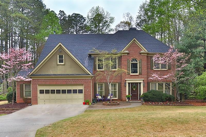 Hurry! Wonderful traditional in Alpharetta SWIM/TENNIS neighborhood! TOP schools: Brookwood Elementary, Piney Grove Middle, and South Forsyth High! Enjoy home both indoors and out with a great screened in porch that leads to FLAT, fully FENCED backyard and ROOFTOP deck off the master suite! Large kitchen offers tons of storage/prep space, double ovens, island, walk-in pantry, and office nook. OPEN concept family room boasts a gas fireplace and built-ins. Dining room great for entertaining. Main level office with built-in desk and shelving. Beautiful millwork carried throughout. Master suite is a true retreat including a trey ceiling, luxurious master bath, and access to upper level deck. Additional bedrooms well-sized and bright! Laundry up! Great location convenient to interstates, shopping, and restaurants!
