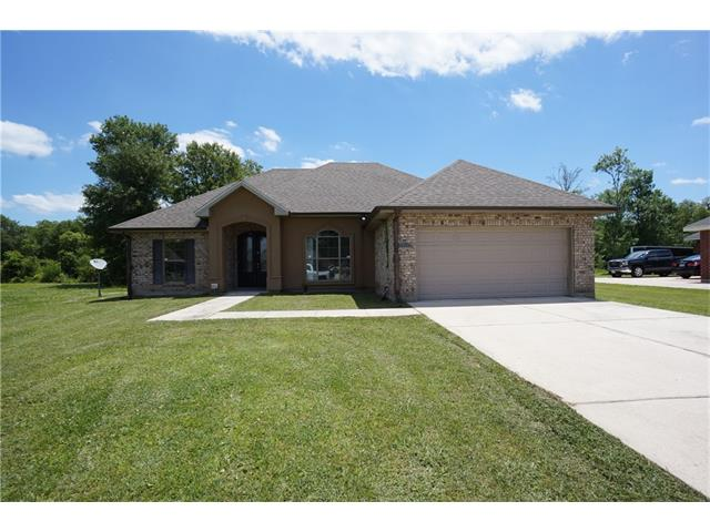 All brick home on large lot at end of cul de sac. Very large bedroom with tray ceiling, master bath has tub and separate shower and large walk in closet.  Attached 2 car garage and porch area in rear. Large den with corner fireplace. Property has been placed in auction format.