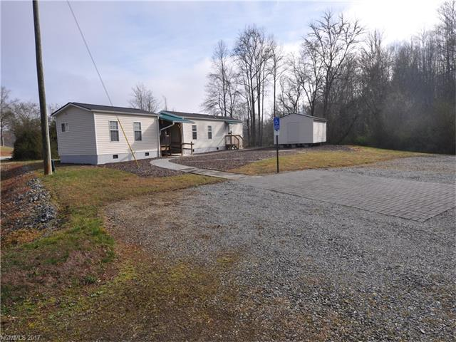 One Bed Room single wide connected to office modular by breezeway, two storage buildings, level site with parking for ten cars, potential for up to 10 multifamily units.  Office unit has bath & kitchenette.  Site has pump sewer, city water, natural gas, three phase electricity, and backs up to potential Ecusta Trail greenway, currently rail road not used. Imagine single wide will rent for $500 and modular for $300, plus several more single wides could be added to the site.  Income potential good