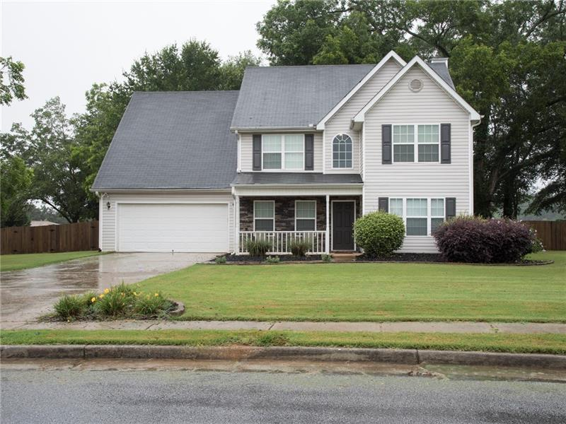 Adorable, spacious 2 story home in Monroe. Two story foyer, sep formal LR & DR. Beautiful stacked stone fire place & large kitchen w/SS appliances. The garage is very large and longer then most, giving you extra space for storage. Once upstairs, you will find the master bedroom with trey ceilings, separate garden tub/shower and spacious walk in closet overlooking private backyard. 2 addtl bdrms & full bath lead you to the 4th bdrm/bonus rm that has a cedar ceiling & walls. Fresh paint & new carpet throughout home. Don't miss the large, fenced in backyard w/storage shed!