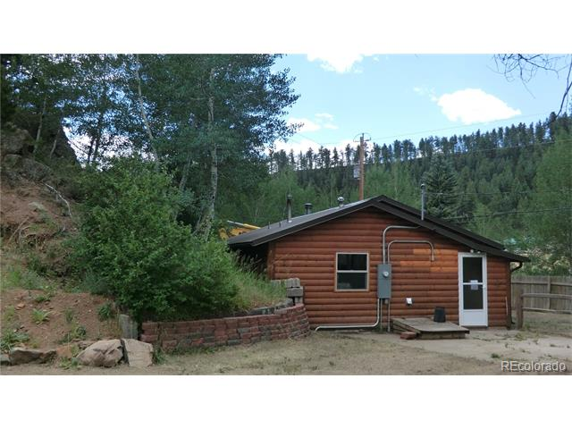 Huge workshop - twice the size of the house!  But cabin is so-o-o cute!!  Fenced yd, easy access yet sheltered from highway.  All new inside:  cabinets, counters, fixtures, windows, paint, doors, and even the water heater!  Metal roof, cute rock trim.  Ready for quick move-in.
