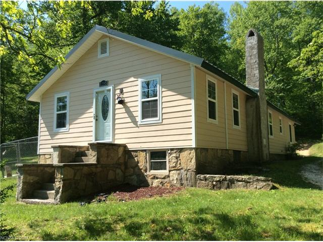 Lovely single family home on large lot with mountain views. Home features a newer metal roof, large side deck, and a babbling creek that runs the property line.